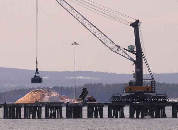 Tons of rock salt sits piled up at the Sprague Energy Terminal at Mack Point in Searsport Tuesday.  The salt is awaiting the arrival of a barge to bring it down to New Jersey. The expected snowstorm is likely to delay the arrival of the barge, according to an official from Sprague Energy, which owns the port.