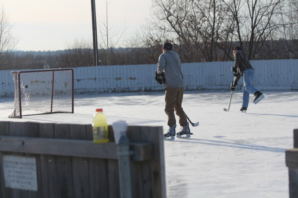 Jacob Cyr, 20, of Bangor (far left) and his friend Ryan Tesseo, 21, of Orrington, practice ice hockey skills on Feb. 4, 2014, at the Caldwell Ice Rink in Brewer.