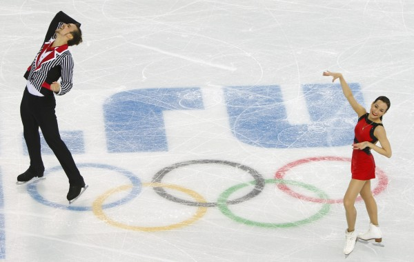 Ksenia Stolbova (right) and Fedor Klimov of Russia finish their figure skating team pairs free skating at the Sochi 2014 Winter Olympics on Saturday.