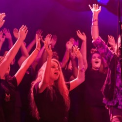"Kelly Hansen, right, lead singer of rock band Foreigner, is accompanied by the Deering High School chorus in a performance of the band's 1984 hit song ""I Wanna Know What Love Is"" during a sold-out show Tuesday, Feb. 18, at the State Theatre in Portland."