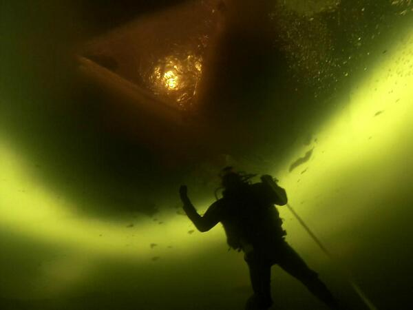 Maine State Police Trooper Elisha Fowlie dives below the ice of Moosehead Lake during a training dive this week.