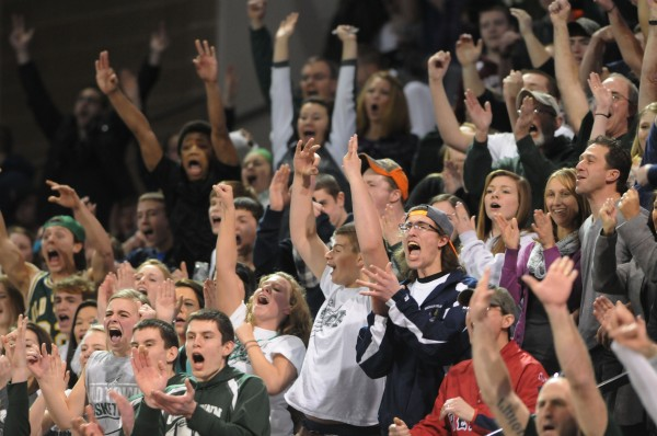 Old Town boys basketball fans cheer on their team as they defeat Caribou 43-41 on Saturday during Eastern Maine Class B action at the Cross Insurance Center in Bangor.
