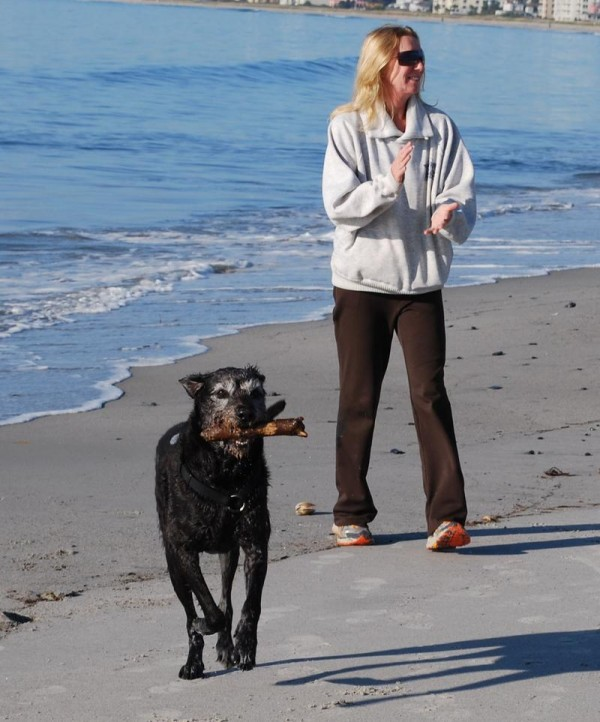 Marilynn Windust, a visitor from Phoenix, Ariz., plays with her dog, Jack, on Pine Point Beach in Scarborough on Wednesday, Oct. 2, 2013.