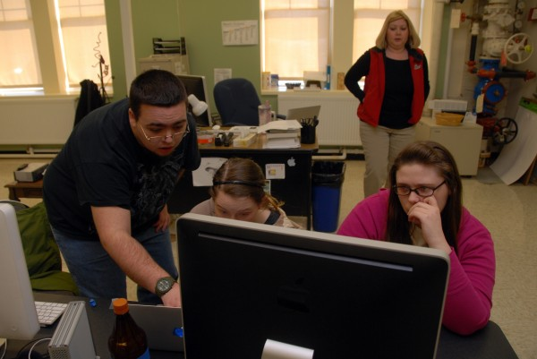Mark Sullivan, a post-grad student at Northern Penobscot Tech, helps 18-year-old Brianna Davis of Millinocket and 18-year-old Sylvia Crocker of Lincoln with video editing in Leigh Thurlow's multimedia class on Tuesday. The class might soon be producing a video for the town of Lincoln.