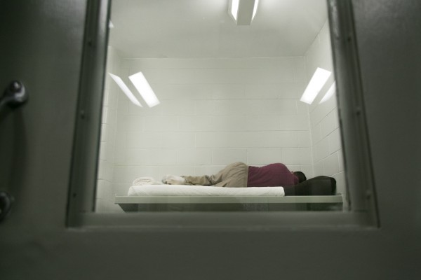 In this March 2013 file photo, a CARA participant rests inside a cell at the Kennebec County Correctional Facility. Many CARA participants come from broken homes and traumatic childhoods, said Kennebec County corrections officer Edward Anderson.