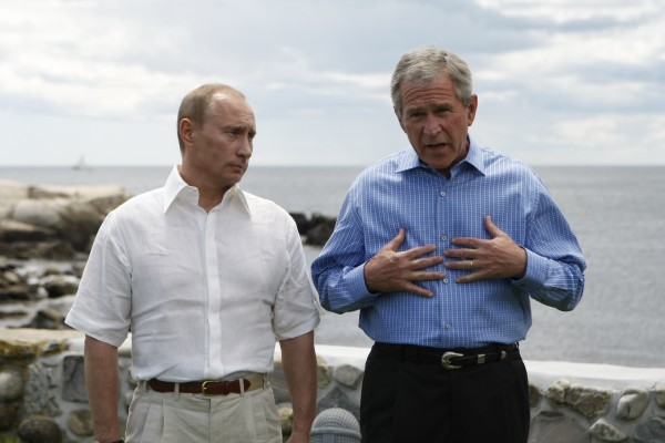 President Bush (right), accompanied by Russian President Vladimir Putin, gestures during a joint statement at the Bush family compound on Walker's Point in Kennebunkport.