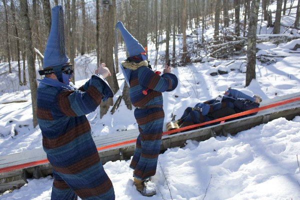 Oscar Verest (left) and Dan Bookham photograph their other two team members of the Royal Dutch National Toboggan Team on Saturday afternoon during the 24th Annual U.S. National Toboggan Championships in Camden.