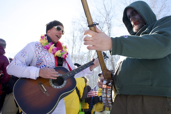 &quotElvis&quot Wayne Talley (left) and BDN photographer and zombie Troy Bennett play Blue Suede Shoes during the costume parade at the 24th Annual U.S. National Toboggan Championships in Camden on Saturday.