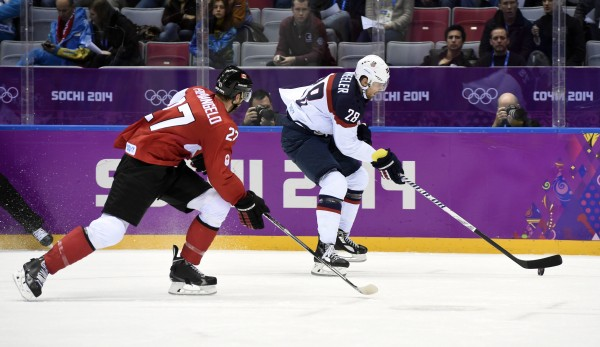 USA forward Blake Wheeler (right) carries the puck past Canada defenseman Alex Pietrangelo in the men's ice hockey semifinals during the Sochi 2014 Olympic Winter Games at Bolshoy Ice Dome on Friday. Canada defeated the U.S. 1-0.