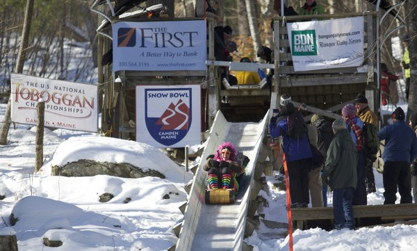 Team Shear Madness races down the chute at Camden Snow Bowl during the 24th Annual U.S. National Toboggan Championships in Camden on Saturday.