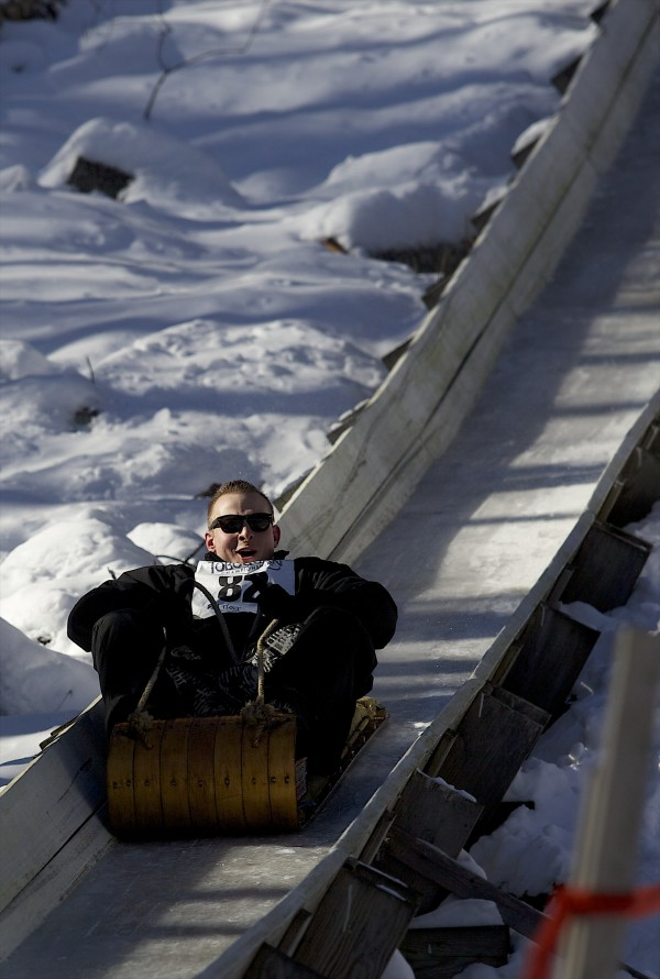 Raise The Roof slides down the chute at Camden Snow Bowl during the 24th Annual U.S. National Toboggan Championships in Camden on Saturday.