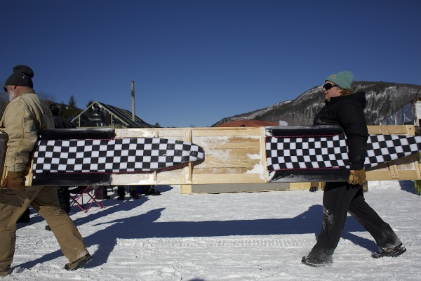 Doug Fagley (left) and Jess Fagley carry their toboggan after racing in the 24th Annual U.S. Toboggan National Championships in Camden on Saturday.