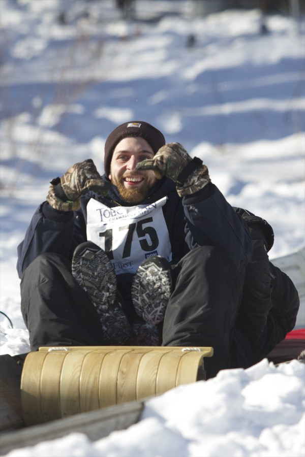 The Mountain Street Chuters slide down the chute at Camden Snow Bowl during the 24th Annual U.S. National Toboggan Championships in Camden on Saturday.
