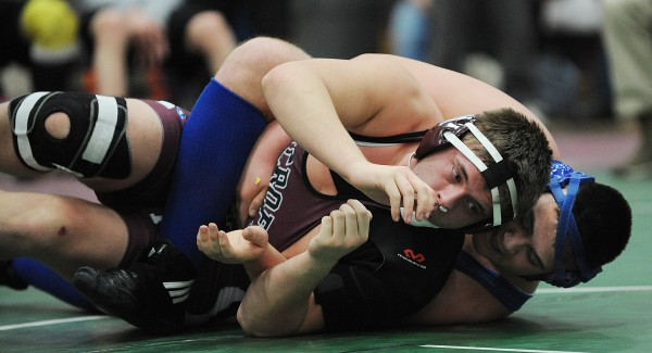 Hermon's Luke Potter (right) and Dover-Foxcroft's Devin Madigan compete in the championship match Saturday in the 285-pound weight class during the PVC wrestling championships in Ellsworth. Potter pinned Madigan for the win.