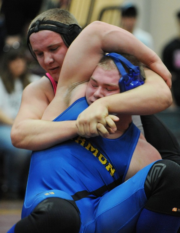 Hermon's Alex Urquhart (right)  and Ellsworth's Michael Garland compete in the championship match in the 220-pound weight class during the PVC wrestling championships Saturday in Ellsworth. Garland pinned Urquhart for the win.