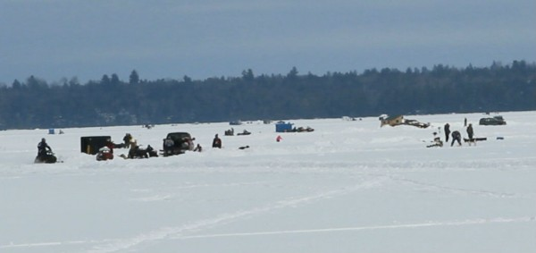 Ice anglers take part in the 52nd annual Schoodic Lake Ice Fishing Derby off Knight's Landing in Brownville on Saturday, Feb. 15, 2014.