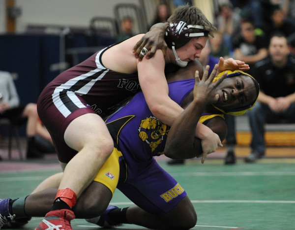 Bucksport's KP Hilaire (right)  and Dover-Foxcroft's Corbyn Bruce compete in the championship match Saturday in the 195-pound weight class during the PVC wrestling championships in Ellsworth. Bruce won 4-3.