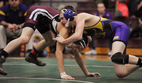 Bucksport's Matt Stewart (right) and Dover-Foxcroft's Brooks Law compete Saturday in the championship match in the 138-pound weight class during the PVC wrestling championships in Ellsworth. Law won.
