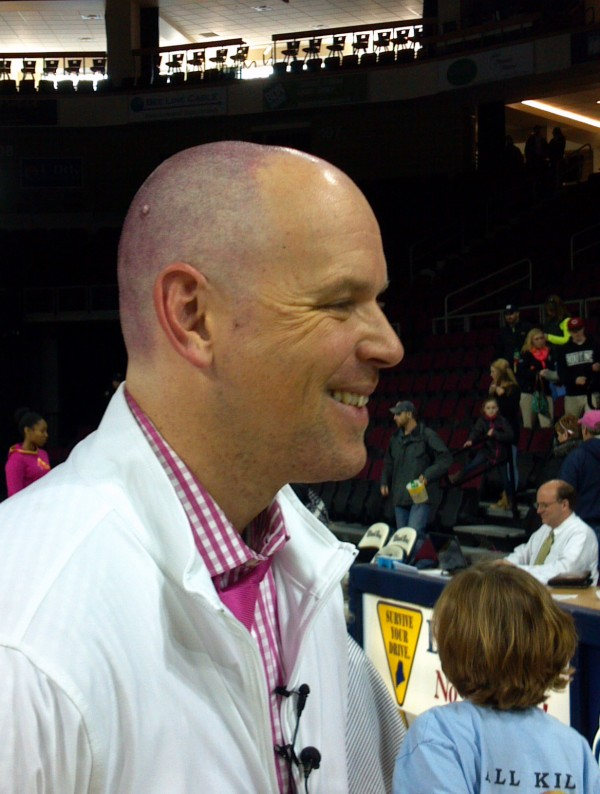 UMaine women's basketball coach Richard Barron speaks to members of the media Sunday after having his head shaved in the wake of the program's successful fundraising effort for the &quotPlay4Kay&quot breast cancer initiative.