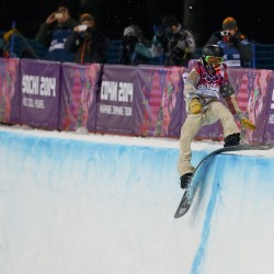 Shaun White of the U.S. crashes during the men's snowboard halfpipe final event at the 2014 Sochi Winter Olympic Games, in Rosa Khutor February 11, 2014.