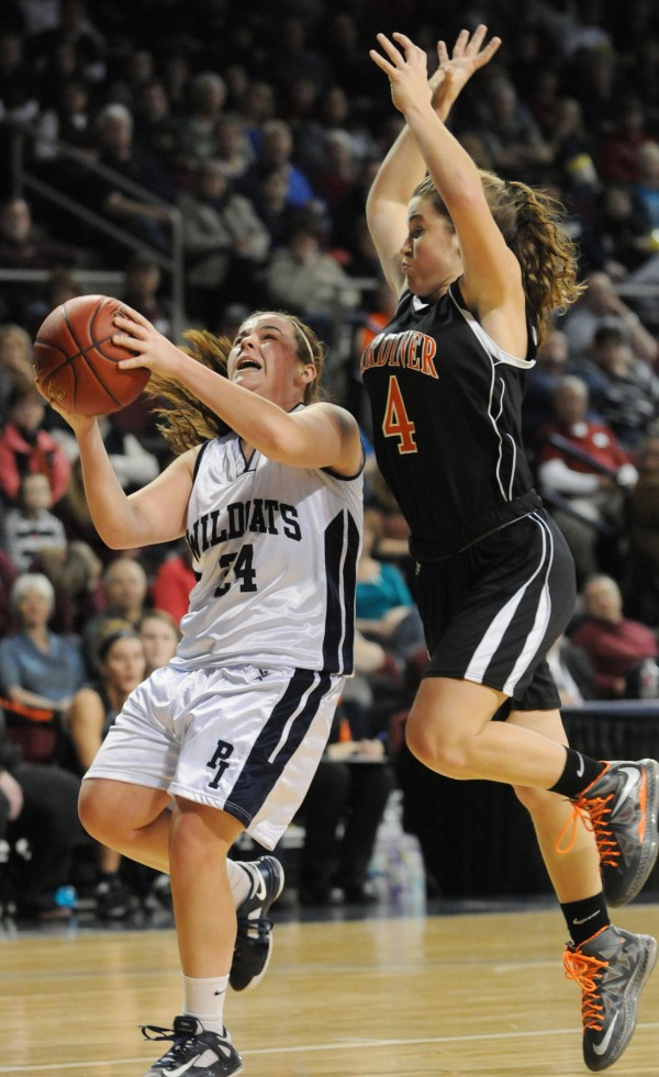 Presque Isle's Taylor Williams is fouled by  Gardiner's Laren Chadwick  on Saturday at the Cross Insurance Center in Bangor.