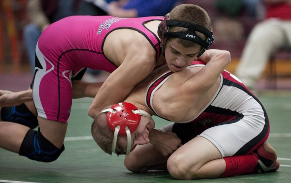 Ellsworth's Noah Robidoux (left) and Dexter's Dillion Garnett compete in the championship match in the 113-pound weight class during the PVC wrestling championships Saturday in Ellsworth. Ribidoux defeated Garnett.