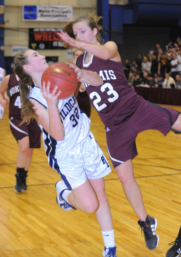 Nokomis' Kelsie Richards (right) tries to block Presque Isle's Hannah Graham as she drives for the basket players during the first half of the Eastern Maine Class B championship game in Bangor on Saturday, Feb, 23, 2013.