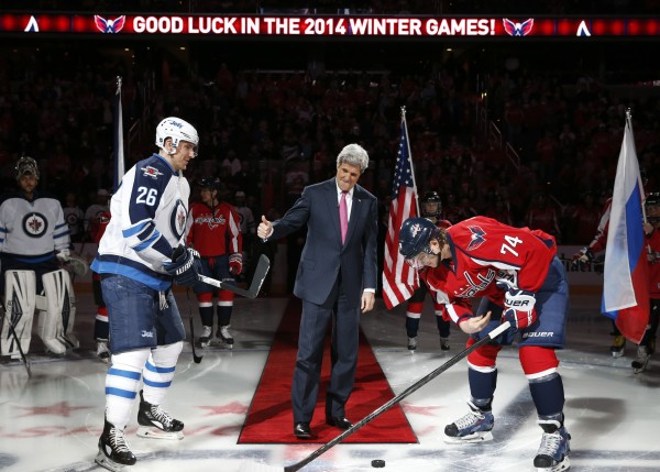 In this February 2014 file photo, Secretary of State John Kerry (center) gives thumbs up as he participates in a ceremonial puck drop with Winnipeg Jets right wing Blake Wheeler (left) and Washington Capitals defenseman John Carlson at the Verizon Center.