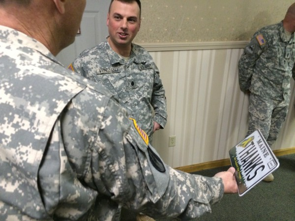 Commander Ron Ireland, a Chief Warrant Officer 5, who just completed his fifth deployment leading eight members of Detachment 14, Operational Support Airlift Command in Afghanistan, shows off a special license plate that says, &quotThanks&quot given to him by Brewer veteran and troop greeter Charles &quotDusty&quot Fisher (not pictured) to Lt. Col. Brian Veneziano, the State Aviation Officer. &quotWe're going to have to find a place to display this,&quot Ireland said.