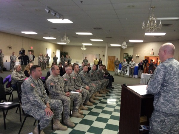 Brig. Gen. James Campbell, adjutant general for the Maine National Guard, thanks eight Maine Army National Guard members of the Bangor-based Detachment 14, Operational Support Airlift Command and their families at the unit's freedom salute on Sunday, Feb. 2, 2014. Gov. Paul LePage, U.S. Rep. Mike Michaud, and other dignitaries also thanks the soldiers and their loved ones.