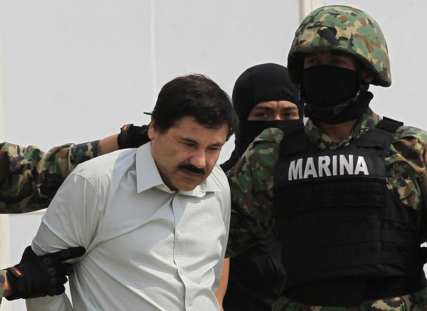 Joaquin &quotShorty&quot Guzman (left) is escorted by soldiers during a presentation at the Navy's airstrip in Mexico City on Saturday. Mexico has captured its most wanted man, drug kingpin Guzman, President Enrique Pena Nieto said via Twitter on Saturday, in a major victory in a long, grisly fight against drug gangs. Guzman, known as &quotEl Chapo&quot (Shorty) in Spanish, runs Mexico's infamous Sinaloa Cartel and over the past decade emerged as one of the world's most powerful organized crime bosses.
