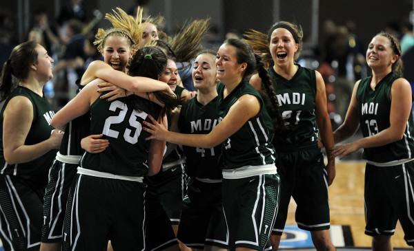 The MDI girls celebrate a 63-51 win over Presque Isle on Saturday in the Eastern Maine Class B final at the Cross Insurance Center in Bangor.