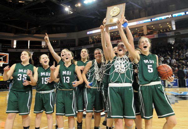 MDI's girls team celebrates its 63-51 win over Presque Isle on Saturday in the Eastern Maine Class B final at the Cross Insurance Center in Bangor.