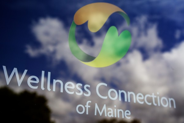 In this September 2013 file photo, lettering on the door at the Wellness Connection of Maine, a medical marijuana dispensary with four locations in Maine, marks its Portland office.