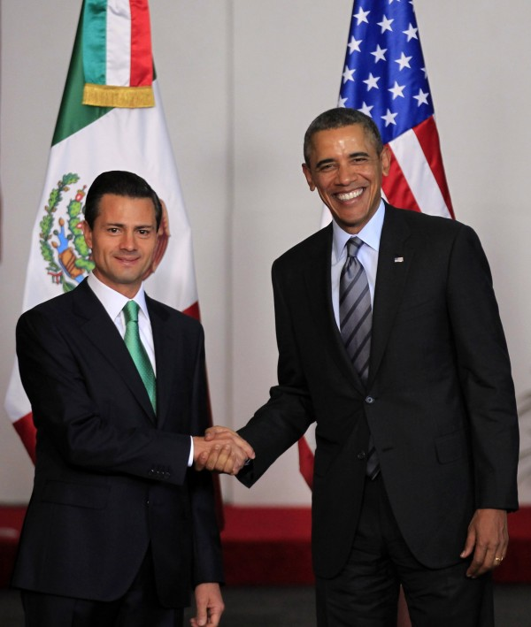 Mexican President Enrique Pena Nieto shakes hands with U.S. President Barack Obama after Obama arrived to attend the North American Leaders' Summit in Toluca near Mexico City.