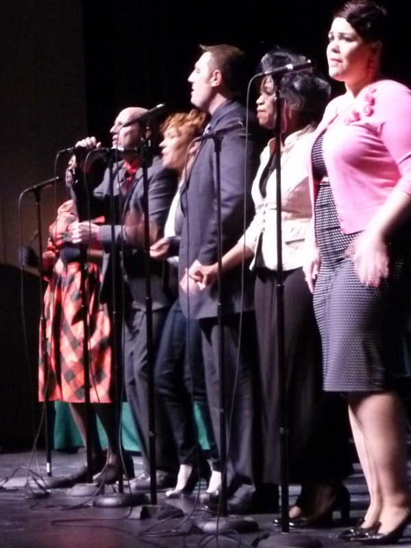 Members of the Destiny Worship Center's Praise Team sing Sunday in Gracie Theatre at Husson University for a Black History Month event that celebrated the 1963 March on Washington.