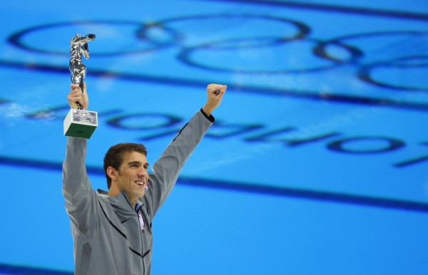 Michael Phelps of the U.S. holds up his award recognising him as the most decorated Olympian, during the London 2012 Olympic Games at the Aquatics Centre in 2012.