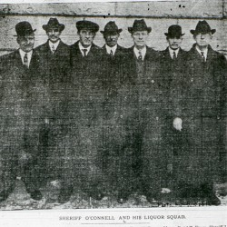 This photograph of Sheriff J. Fred O''Connell''s liquor squad, shot by local photographer Leyland Whipple, appeared in the Bangor Daily News on Jan. 10, 1914. O''Connell stands third from the right.