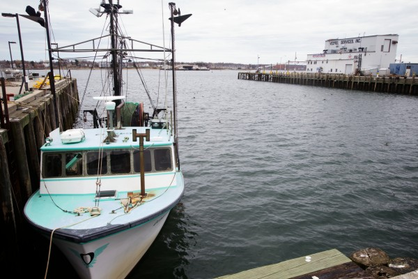 A groundfishing boat is tied up outside the Portland Fish Exchange in April.