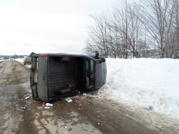 A Littleton woman was taken to Houlton Regional Hospital after hitting a snowbank as she tried to avoid striking a stopped vehicle Saturday afternoon.
