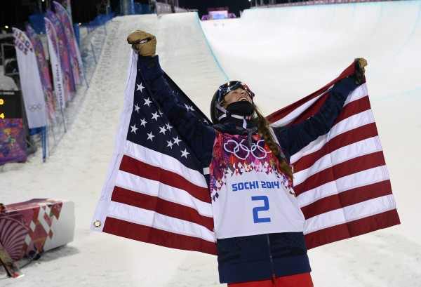 Maddie Bowman of the U.S. celebrates with the U.S. flag after winning the women's freestyle skiing halfpipe finals at the 2014 Sochi Winter Olympic Games in Rosa Khutor on Thursday.