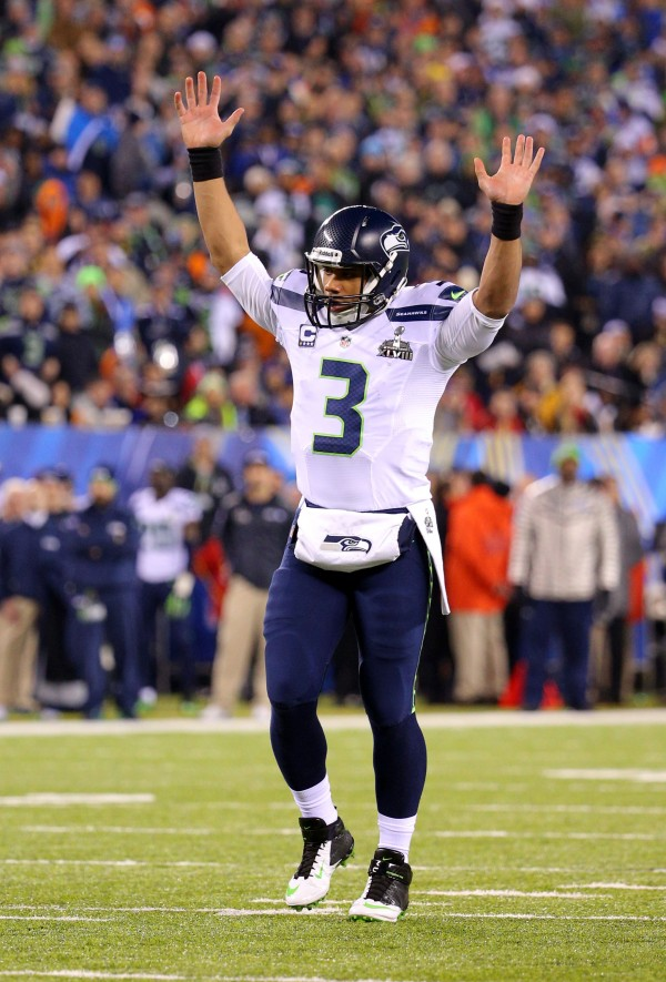 Seattle Seahawks quarterback Russell Wilson (3) celebrates throwing a touchdown pass during the second half against the Denver Broncos in Super Bowl XLVIII at MetLife Stadium in East Rutherford, N.J., Sunday night.
