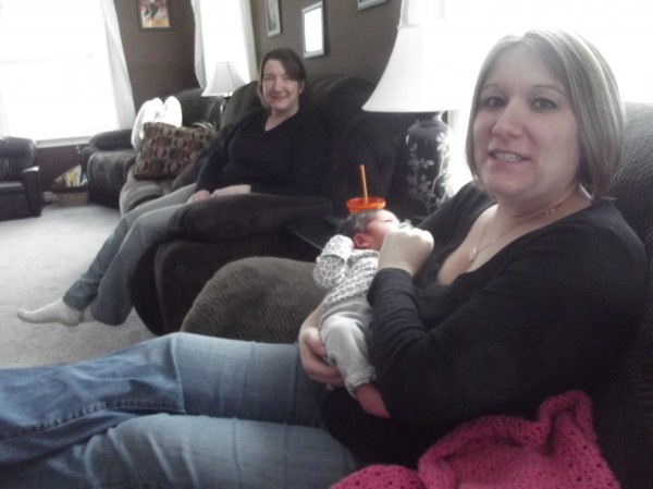 Christina Bridges holds her newborn daughter, Addison, who was delivered with telephone assistance from a Washington County emergency dispatcher. Also shown is Beth Hawkins, Bridges' mother, who called 911.