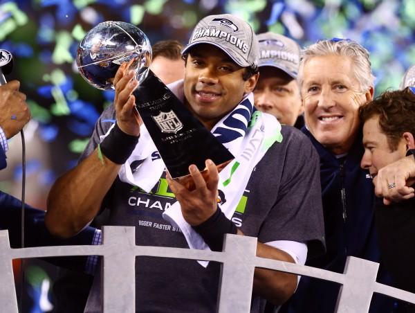 Seattle Seahawks quarterback Russell Wilson holds the Vince Lombardi Trophy after Super Bowl XLVIII against the Denver Broncos at MetLife Stadium on Sunday evening.