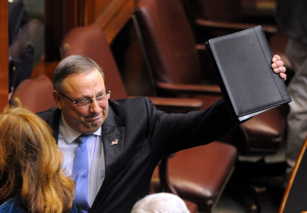 In this February 2014 file photo, Gov. Paul LePage waves as he leaves the House of Representatives chamber after he delivered his 2014 State of the State address at the State House in Augusta