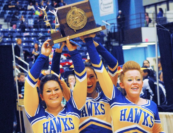 Kaitlinn Turner, Alivia Brown and Taylor Smith of the Hermon High School Hawks raise their trophy after winning the Class B State Cheering Championship at the Augusta Civic Center on Saturday.