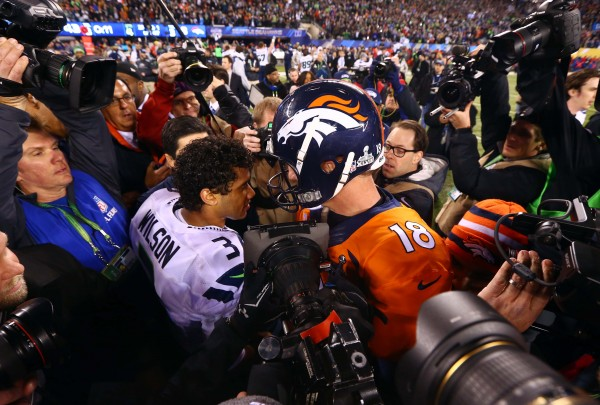 Seattle Seahawks quarterback Russell Wilson (3) shakes hands with Denver Broncos quarterback Peyton Manning (18) after Super Bowl XLVIII at MetLife Stadium on Sunday night.