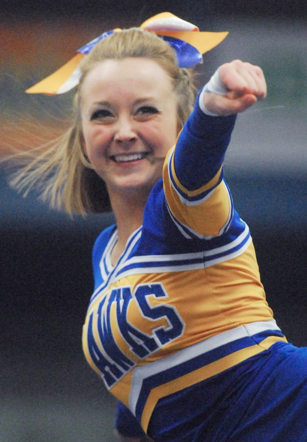 Hermon High School's Erica Turmel cheers while being held high in the air by the team during the Class B State Cheering Championship at the Augusta Civic Center on Saturday.