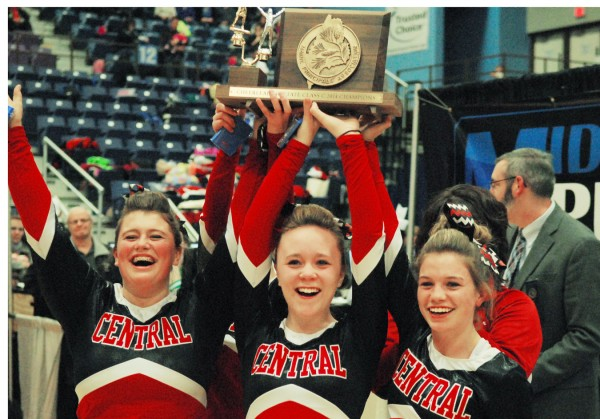 Autumn Preble (from left), Melyssa Prescott and Hillary Williams of Central High School hold the trophy after winning the Class C State Cheering Championship on Saturday at the Augusta Civic Center.