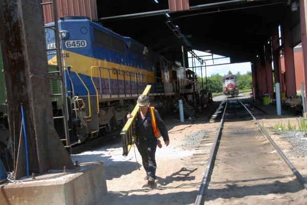 In this July 2012 file photo, Montreal, Maine & Atlantic Railway worker David Black helped repair and test several locomotives in the company rail yard in Derby. Railroad Acquisition Holdings, the affiliate of Fortress Investment Group that is in the process of buying MMA out of bankruptcy, will change the railroad company''s name to the Central Maine and Quebec Railway.